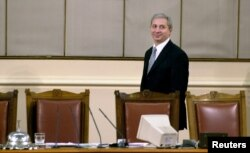 FILE - Bulgarian parliament speaker Ognyan Gerdzhikov leaves his desk at the parliament in Sofia, Feb. 4, 2005.