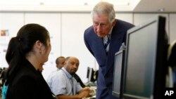Britain's Prince Charles talks to a computer student at the Carlos Rosario International Public Charter School for Adults in Washington, March 19, 2015.