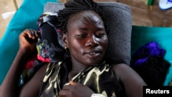 FILE - A South Sudanese woman suffering from cholera lies on a bed at Juba Teaching Hospital in Juba, May 27, 2014.