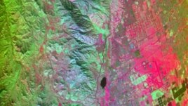 California's San Andreas Fault region captured by the HyspIRI airborne campaign equipment, March 29, 2013: Red areas are composed of minerals high in silica, such as urban areas; darker and cooler areas are composed of water and heavy vegetation, NASA file image.
