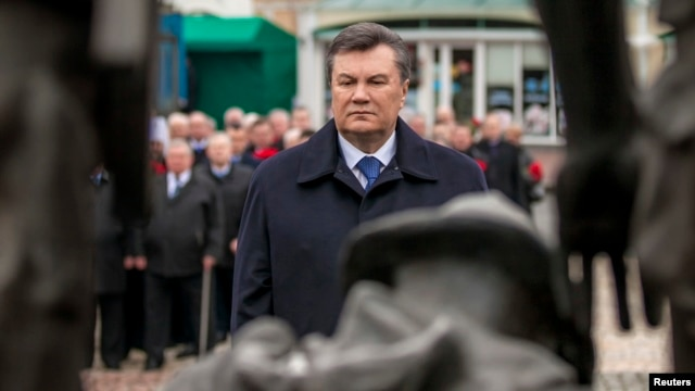 Ukraine's President Viktor Yanukovich takes part in a ceremony at the memorial complex for Soviet Ukrainian-born victims of a military conflict in Afghanistan, Kyiv, Feb. 14, 2014.