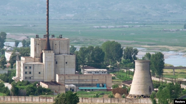 A North Korean nuclear plant is seen before demolishing a cooling tower (R) in Yongbyon, in this photo taken June 27, 2008 and released by Kyodo. North Korea is to restart the mothballed Yongbyon nuclear reactor that has been closed since 2007.