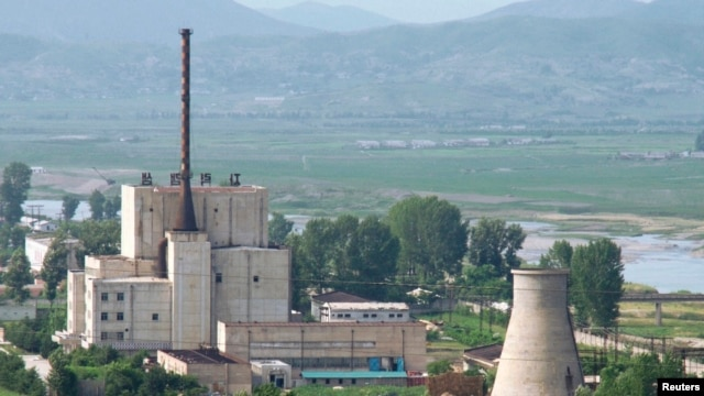 A North Korean nuclear plant is seen before demolishing a cooling tower (R) in Yongbyon, in this photo taken June 27, 2008 and released by Kyodo. North Korea is to restart the mothballed Yongbyon nuclear reactor that has been closed since 2007 in a move t