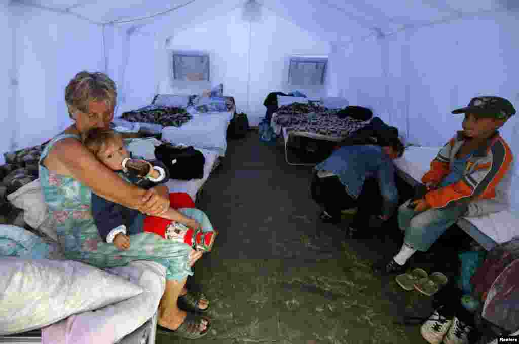Families pour into Ukrainian refugee encampments, outside Donetsk, Aug. 18, 2014.