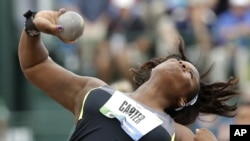 Michelle Carter competes in the final round of the women's shot put at the U.S. Olympic Track and Field Trials,, June 29, 2012, in Eugene, Oregon.