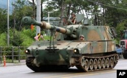FILE - A South Korean army K-55 self-propelled artillery vehicle moves through a military exercise near the demilitarized zone between the two Koreas in Cheorwon, South Korea, Aug. 21, 2017. U.S. and South Korean troops kicked off their annual drills Monday.