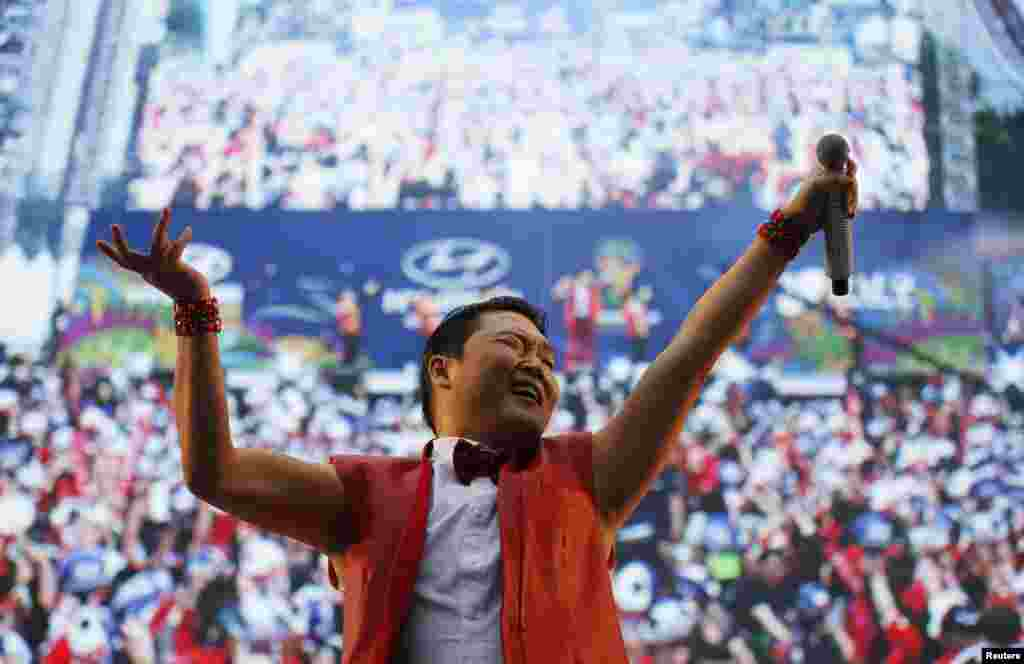 South Korean rapper Psy performs during a public screening before the 2014 World Cup Group H soccer match between South Korea and Russia, in Seoul, June 18, 2014.