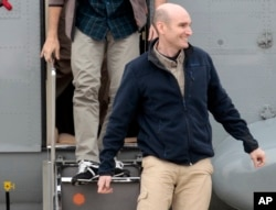 FILE - In this April 20, 2014 file photo, released French hostage Nicolas Henin arrives at the Villacoublay military airbase, outside Paris. He was released with other French journalists who had been held since June 2013.