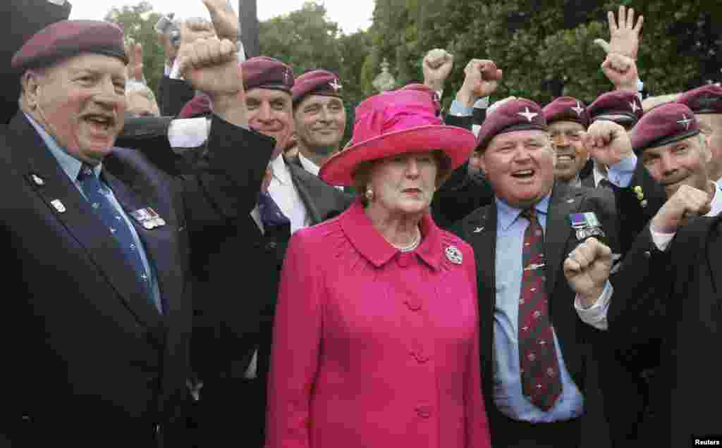 Former British Prime Minister Margaret Thatcher and Falklands veterans take part in a march in London, during a service to commemorate the 25th anniversary of the Falkland Islands conflict, June 17, 2007.