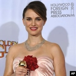 "Natalie Portman holds her award for Best Performance by an Actress in a Motion Picture - Drama for her role in ""Black Swan,"" at the Golden Globe Awards 16 Jan. 2011, in Beverly Hills, California."
