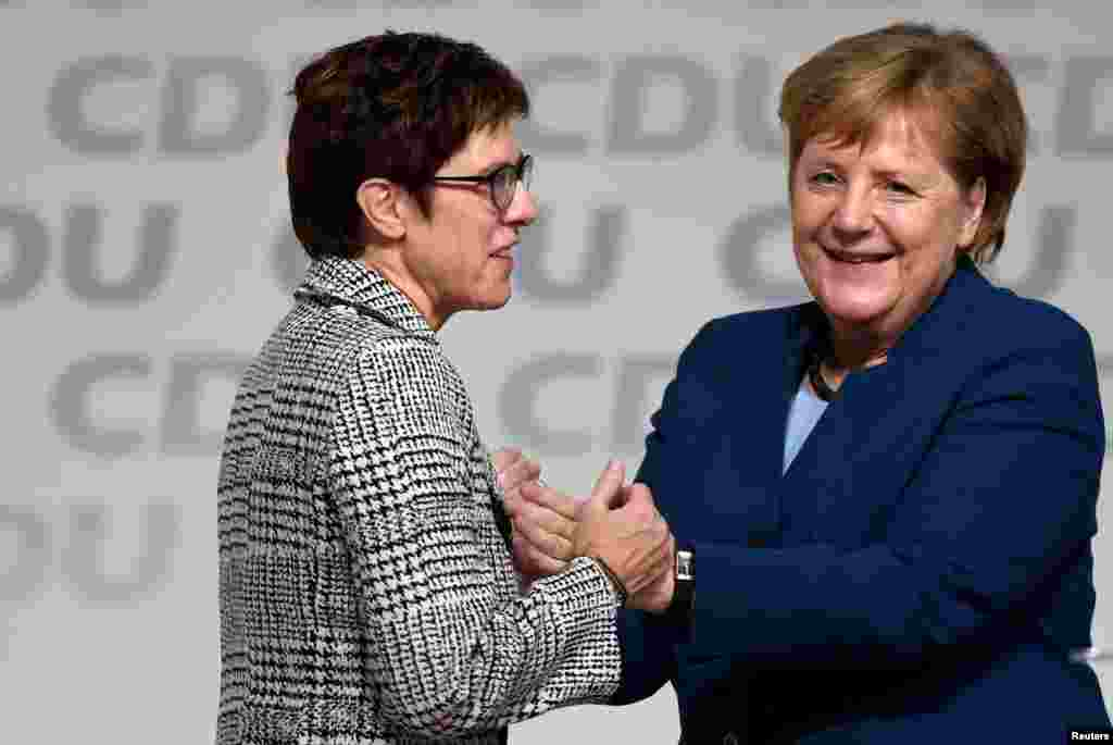 Annegret Kramp-Karrenbauer is hugged by German Chancellor Angela Merkel after being elected as the party leader during the Christian Democratic Union (CDU) party congress in Hamburg, Germany. Merkel was not running for another term.
