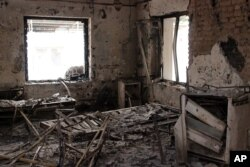 FILE - The charred remains of the Doctors Without Borders hospital is seen after it was hit by a U.S. airstrike in Kunduz, Afghanistan, Oct. 16, 2015.