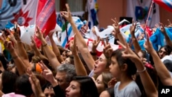 In this April 2, 2014 file photo, activists sing the national anthem during a ceremony marking the 32th anniversary of the start of the Falkland conflict, in Buenos Aires, Argentina. (AP Photo/Victor R. Caivano)