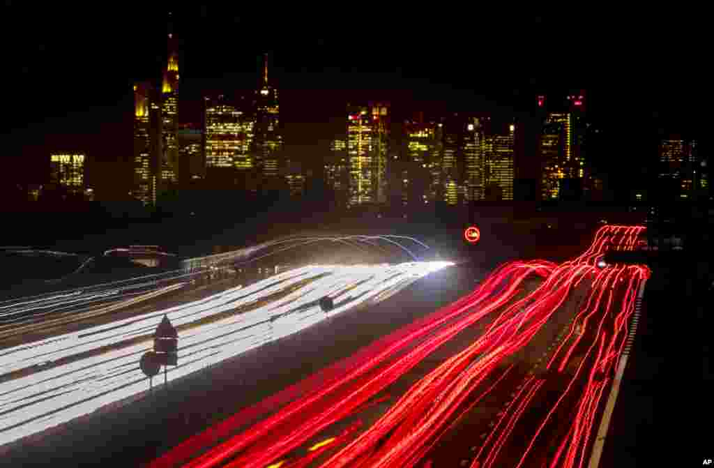 A long time exposure photo shows cars and trucks driving on a highway near Frankfurt, Germany.