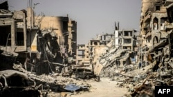 Des ruines d'immeubles à Raqa, en Syrie, le 21 octobre 2017