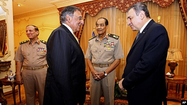 Defense Secretary Leon Panetta meets with Egyptian Field Marshal Mohamed Hussein Tantawi, second from right, and Egyptian Prime Minister Essam Sharaf at the Financial Authority House in Cairo, Egypt, October 4, 2011.
