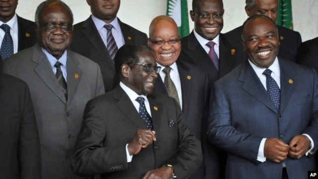 South Africa's President Jacob Zuma, center-right, and Zimbabwe's President Robert Mugabe, center-left, share a joke as Gabon's President Ali Bongo Ondimba, right, looks on at the African Union summit in Addis Ababa, Ethiopia, May 26, 2013.