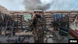 This photo posted on Iran's state-run news agency site IRNA purportedly shows a child being trained to fire weapons at Iran's perceived Western enemies.