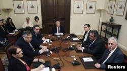 Greek political leaders (from left to right) Aleka Papariga, Evangelos Venizelos, Antonis Samaras, Greek President Karolos Papoulias, Alexis Tsipras, Panos Kammenos and Fotis Kouvelis meet at the presidential palace in Athens, May 16, 2012.