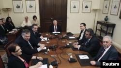 Greek political leaders (from left to right) Aleka Papariga, Evangelos Venizelos, Antonis Samaras, Greek President Karolos Papoulias, Alexis Tsipras, Panos Kammenos and Fotis Kouvelis meet at the presidential palace in Athens, May 16, 2012.
