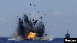FILE - The Indonesian navy scuttles foreign fishing vessels caught fishing illegally in Indonesian waters near Bitung, North Sulawesi, May 20, 2015. A total of 19 foreign boats from Vietnam, Thailand, Philippines and one from China were destroyed as part of an ongoing crackdown illegal fishing. (Reuters/Fiqman Sunandar/Antara Foto)