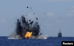 The Indonesian navy scuttles foreign fishing vessels caught fishing illegally in Indonesian waters near Bitung, North Sulawesi, May 20, 2015. A total of 19 foreign boats from Vietnam, Thailand, Philippines and one from China were destroyed.
