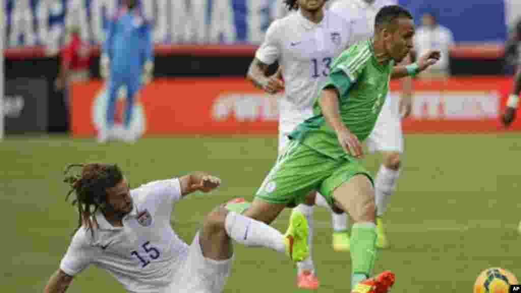 Nigeria's Peter Odemwingie gets control of the ball away from United States's Kyle Beckerman.