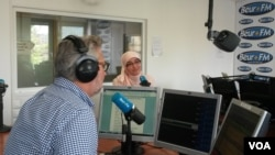Nadia El Bouga at Beur FM. Increasingly, El Bouga's frank parlance is gaining attention. (L. Bryant/VOA)