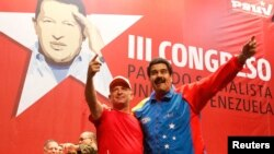 Venezuela's President Nicolas Maduro (R) embraces retired General Hugo Carvajal as they attend the Socialist party congress in Caracas, Venezuela, July 27, 2014.