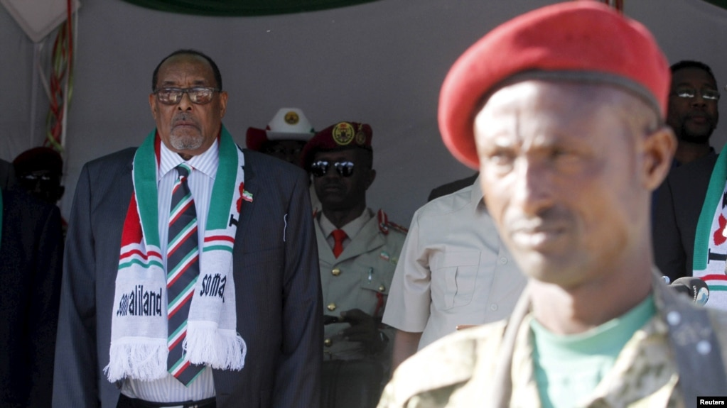 FILE - President Ahmed Mohamed Silanyo stands to salute troops during a street parade to celebrate independence day for the breakaway Somaliland nation from Somalia in the capital, Hargeysa, May 18, 2015.