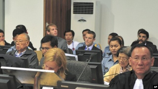 Former Khmer Rouge foreign minister Ieng Sary (2nd row from front, L) and former social affairs minister Ieng Thirith (2nd row from front, 2nd R) sit at the Extraordinary Chambers in the Courts of Cambodia (ECCC) on the outskirts of Phnom Penh June 27, 2011.