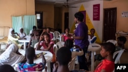 """FILE - Young girls listen to an educational talk at the Bada Primary Health Centre in Lagos, Nov. 11, 2018. The """"9ja Girls"""" is a program aimed at helping young Nigerian girls prepare for adulthood through educational programs and family planning."""