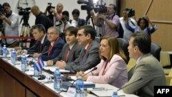 Josefina Vidal, the Cuban Foreign Ministry's chief diplomat for U.S. affairs, second from right, and members of her delegation participate in the first day of closed-door talks between Cuba and the U.S., Havana, Jan. 21, 2015.