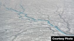 A vast network of previously little-understood rivers and streams that flow on the ice sheet into the ocean could be a major factor contributing to rising sea levels. (UCLA/Lawrence C. Smith)