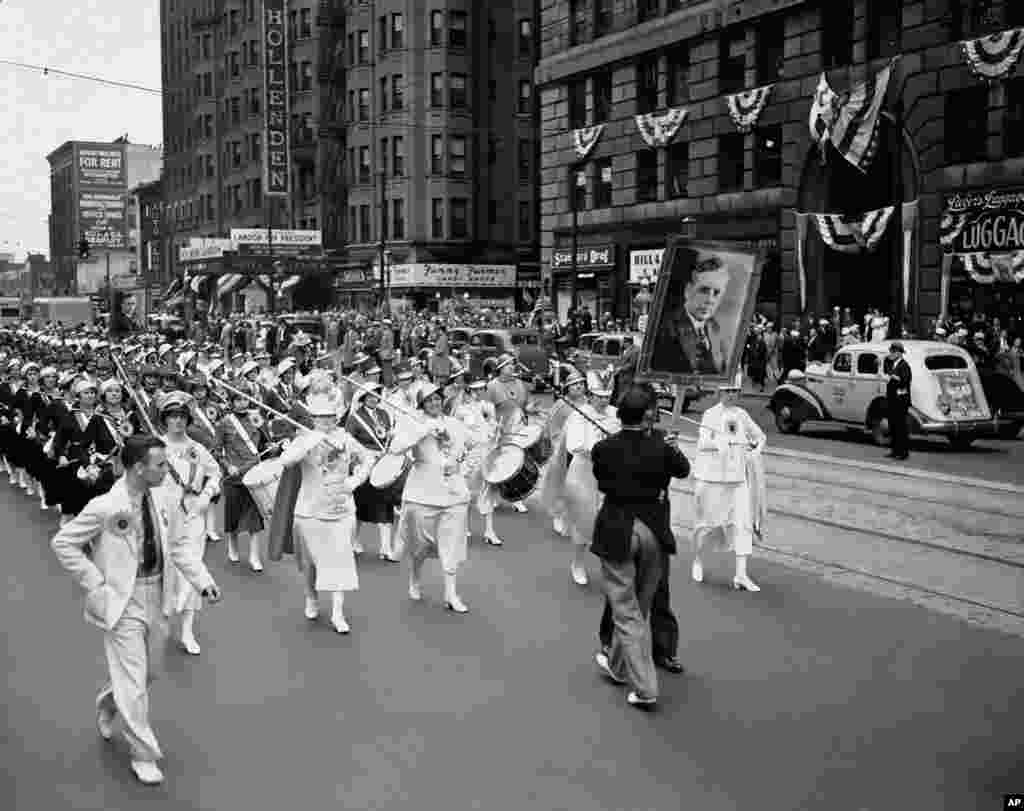 FILE - A drum corps of young women strode through the streets of Cleveland during an Alf Landon-for-president parade in Cleveland to the auditorium where the Republican National Convention was to meet, June 11, 1936. Landon and Frank Knox were nominated as presidential and vice presidential candidates, respectively.