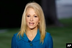 FILE - Kellyanne Conway, senior adviser to President Donald Trump, speaks during an interview outside the White House, in Washington, May 10, 2017. The White House Wednesday posted on its website ethics waivers granted to four ex-lobbyists and numerous ot