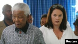 FILE - Former South African President, Nelson Mandela (L), is accompanied by his secretary Zelda Le Grange.