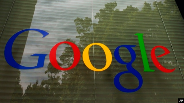 FILE - The Google logo is seen on a window at the company's headquarters in Mountain View, California.