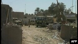 Hiện trường sau vụ nổ bom tự sát tại quân đội Iraq ở tỉnh Diyala, ngày 14/3/2011