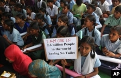 Indian school children participate in a rally to mark World Toilet Day in Hyderabad, India,.