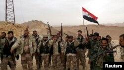 2016年3月26日效忠阿萨德的武装力量庆祝古城帕尔米拉的收复。