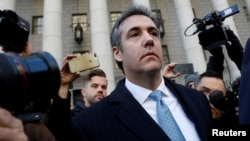 FILE - US. President Donald Trump's former lawyer Michael Cohen exits Federal Court after entering a guilty plea in Manhattan, New York City, U.S., Nov. 29, 2018.