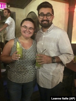 Cat Tjan, 27, and Ammar Farooqi, 26, drink mocktails.