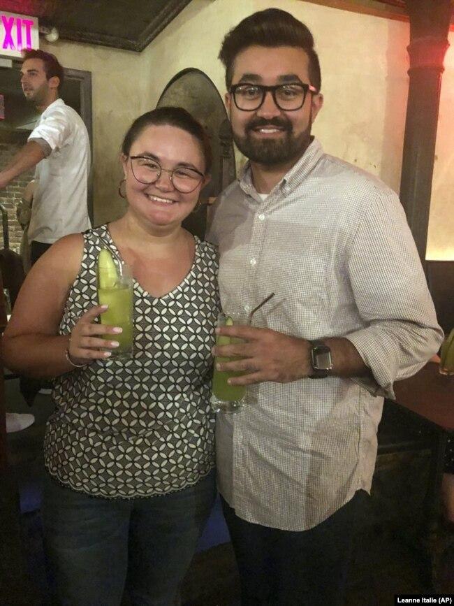 Cat Tjan, 27, and Ammar Farooqi, 26, drink mocktails.
