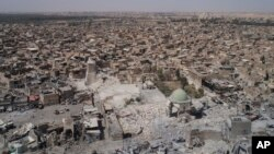 FILE - This aerial view shows the destroyed Grand al-Nuri mosque in the Old City of Mosul, Iraq, June 28, 2017.