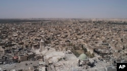 Suasana sekitar Masjid al-Nuri yang hancur di Kota Tua Mosul, Irak, dilihat dari udara, 28 Juni 2017.