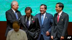 Leaders of Association of Southeast Asian Nations (ASEAN) from left, Malaysian Prime Minister Najib Razak, Sultan of Brunei Hassanal Bolkiah, Cambodian Prime Minister Hun Sen, and Indonesian President Joko Widodo walk back to their seats after posing for a group photo during the opening ceremony of the 25th ASEAN summit at Myanmar International Convention Center in Naypyitaw, Myanmar, file photo.