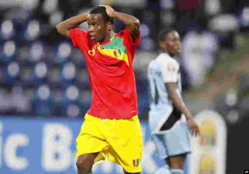 Guinea's Ibrahim Traore (L) reacts during their African Nations Cup Group D soccer match against Botswana at Franceville Stadium January 28, 2012.