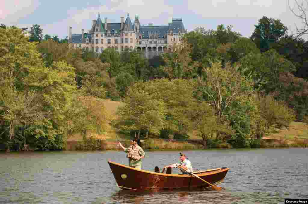 Visitors fly fishing on the grounds of Biltmore.