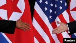 FILE - U.S. President Donald Trump and North Korea's leader Kim Jong Un meet at the start of their summit on the resort island of Sentosa, Singapore, June 12, 2018. Since the summit, North Korea has demanded sanctions relief.